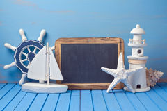 Summer holiday background with chalkboard and decorations. Copy space for text Stock Photos