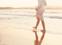 Summer Holiday Background. Female Barefoot are Walking on the Be. Ach in Water. Vacation in Summer at the Sea Royalty Free Stock Photo
