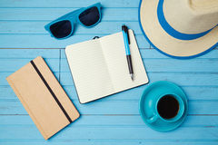 Summer holiday background with notebook and coffee cup. Vacation planning concept. Royalty Free Stock Photos