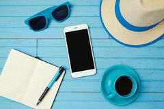 Summer holiday background with smartphone and notebook. Vacation planning concept. royalty free stock photo