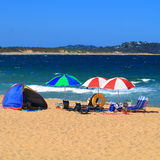 Holiday beach camping. Summer holidays: an adventurous camping at the beach under windy conditions - nobody there (Central Coast, Australia&#x29 Royalty Free Stock Photo