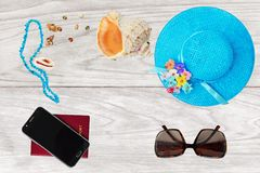 Summer holiday concept, accessories and travel items over wooden background Royalty Free Stock Photos