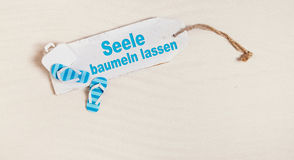 Summer holiday concept with german text for let your mind dangli Stock Photography