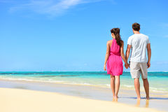 Summer holiday - couple on tropical beach vacation Stock Images