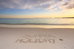 Summer Holiday etched into the sand of beach Royalty Free Stock Image