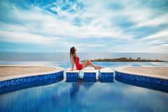 Summer holiday girl fashion concept. Luxury resort woman relaxin Stock Image