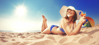 Summer holiday, girl traveling, relax on the beach on a backgrou. Nd of water. Fun summer party in the trip. Woman on vacation Stock Photography