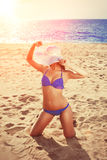 Summer holiday, girl traveling, relax on the beach on a backgrou. Nd of water. Fun summer party in the trip. Woman on vacation Stock Images