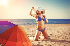 Summer holiday, girl traveling, relax on the beach on a backgrou. Nd of water. Fun summer party in the trip. Woman on vacation Royalty Free Stock Photo