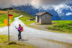 Mountain hiking trails and hiker woman with map, Switzerland, Europe royalty free stock photography