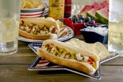 Summer holiday picnic with hot dogs and chips Stock Photo