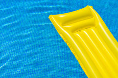 Summer Holiday Recreation Relaxing in Swimming Pool. Summer holiday, recreation in swimming pool with yellow air bed, vacation concept Royalty Free Stock Image