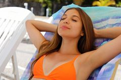 Summer holiday relax. Sexy bikini woman relax and taking a nap near swimming pool resort outdoors the hotel.  stock images