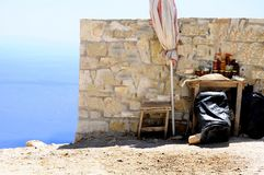 Summer holiday on the road concept- old wall with artisanal albanian honey and sea panorama on the background stock photos