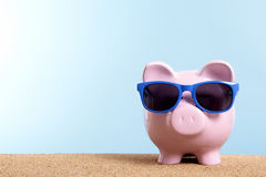 Summer holiday savings concept, travel money planning, Piggy bank on beach vacation, copy space Stock Photography
