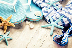 Summer holiday setting with flip flops and beach wear Royalty Free Stock Image