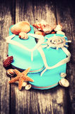 Summer holiday setting with flip flops and sea shells Stock Photography