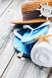 Summer holiday setting with flip flops and straw hat Royalty Free Stock Image