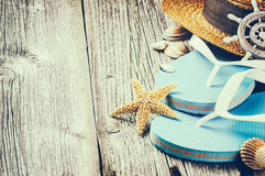 Summer holiday setting with flip flops and straw hat royalty free stock photo