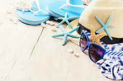 Summer holiday setting with straw hat and flip flops. Copy space stock photo