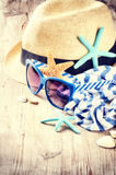 Summer holiday setting with straw hat and sunglasses Royalty Free Stock Photo