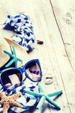Summer holiday setting with straw hat and sunglasses Royalty Free Stock Image