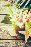 Summer holiday setting with tropical flowers Royalty Free Stock Photo