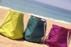 Summer holiday � three vivid bags on the seacoast Royalty Free Stock Photos