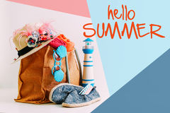 Summer holiday travel concept.Hipster Beach bag with items for a Stock Photos