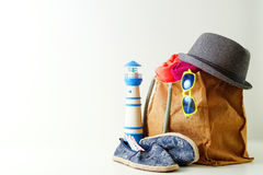 Summer holiday travel concept.Hipster Beach bag with items for a Royalty Free Stock Image
