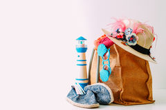 Summer holiday travel concept.Hipster Beach bag with items for a Stock Photography