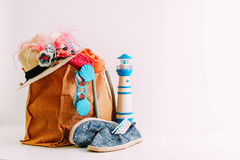 Summer holiday travel concept.Hipster Beach bag with items for a Royalty Free Stock Photo