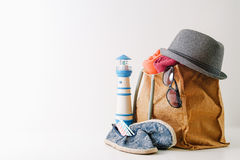 Summer holiday travel concept.Hipster Beach bag with items for a Royalty Free Stock Photography