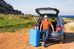 Summer, holiday, trip and vacation concept - Man near the car eady to travel Royalty Free Stock Photo