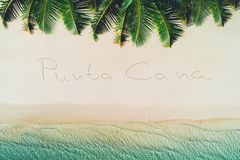 Summer holiday on tropical island. Palm trees and sea waves, Punta Cana. Royalty Free Stock Photos