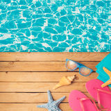 Summer holiday vacation background with sunglasses and flip flops. Royalty Free Stock Photos