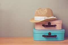 Summer holiday vacation concept with decorative suitcase and hat Stock Image