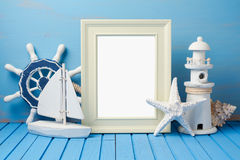 Summer holiday vacation concept with photo frame. And nautical decorations Stock Photos