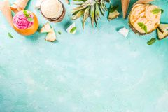 Summer holiday vacation concept, set various tropical ice cream. Sorbets, frozen juices in pineapple, grapefruit and coconut, light blue concrete background Royalty Free Stock Photos