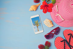 Summer holiday vacation concept  with smartphone and beach items. Royalty Free Stock Photos