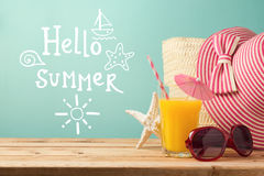 Summer holiday vacation greeting card with orange juice, hat and sunglasses Stock Photo