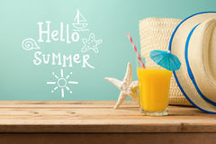 Summer holiday vacation greeting card with orange juice and hat Royalty Free Stock Photos