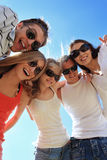 Summer holidays. Cheerful young people having fun on a beach. Great summer holidays Stock Image