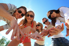 Summer holidays. Cheerful young people having fun on a beach. Great summer holidays Stock Photography