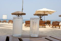 Summer holidays. Two glasses of water at the beach Royalty Free Stock Images