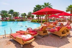 Summer holidays in Abu Dhabi, UAE. ABU DHABI, UAE - MARCH 28: People resting at the pool area of Khalidiya Palace by Rotana on March 28, 2014, UAE. Rotana Hotel Stock Images