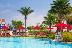 Summer holidays in Abu Dhabi, UAE. ABU DHABI, UAE - MARCH 28: People resting at the pool area of Khalidiya Palace by Rotana on March 28, 2014, UAE. Rotana Hotel Royalty Free Stock Image
