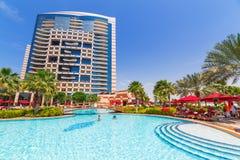 Summer holidays in Abu Dhabi, UAE. ABU DHABI, UAE - MARCH 28: People resting at the pool area of Khalidiya Palace by Rotana on March 28, 2014, UAE. Rotana Hotel Stock Photo