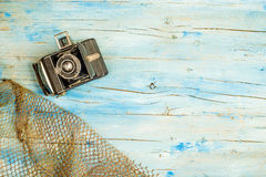 Summer holidays background. Old camera and fishing net on rustic blue wooden background with blank space to write text or put photos stock photos