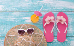 Summer Holidays. Beachwear on wooden background Royalty Free Stock Photography